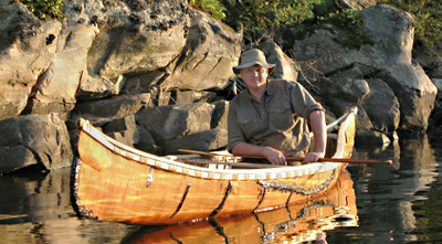 Ray Mears in a traditional birch bark canoe