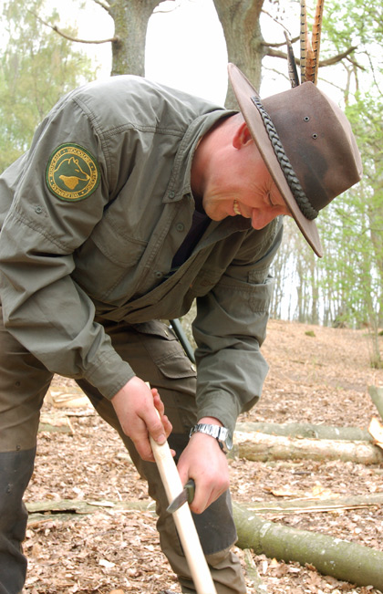 Shaping a wooden peg for a shave horse