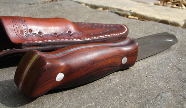 The desert ironwood handle complete with red liners