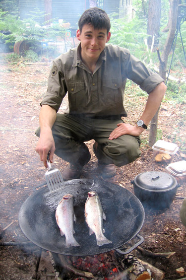A keen fisherman, Dan prepares his catch for the team's supper