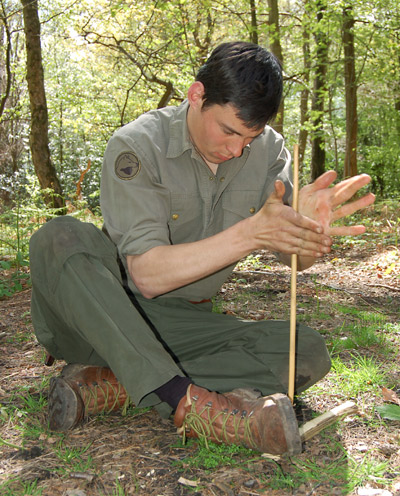 Practising the hand drill technique on our Intermediate Bushcraft course