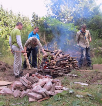 A fire is built and lit on top of the hangi to heat the bricks underneath
