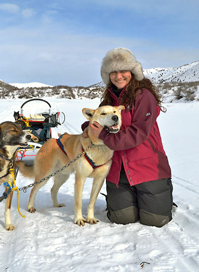 Thalia in Canada with one of her lead sledding dogs, Gomer