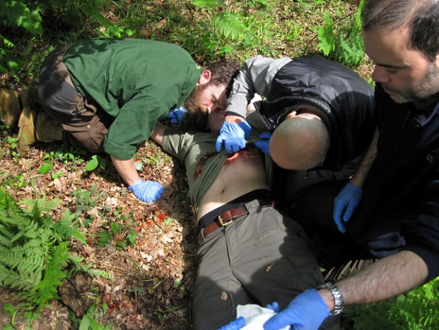 Students rush to the aid of a gunshot wound victim on the WEM2