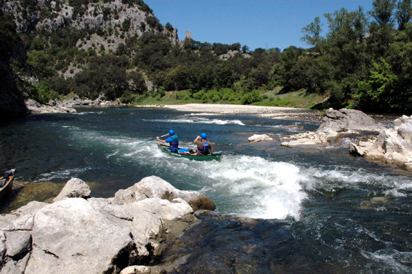 Students tackling the rapids on Woodlore's Canoeing in the Ardeche course
