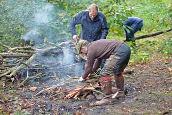 Collecting firewood and starting the fire to heat the rocks