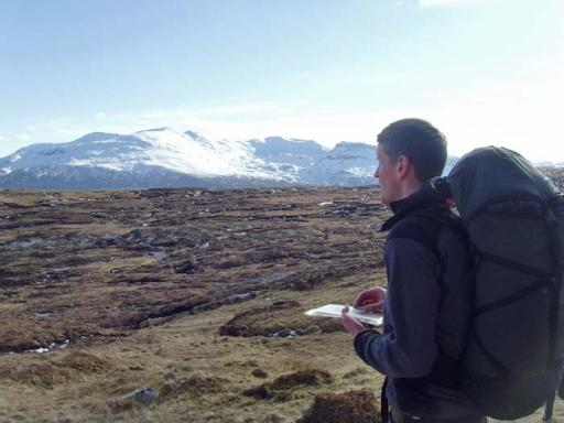 Rob Bashford navigating in the hills of Scotland
