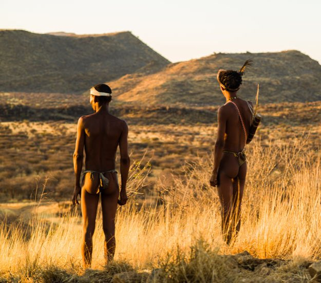 San bushmen gaze over the wilderness