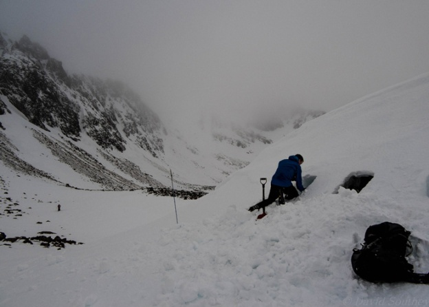 Digging a snow hole for shelter