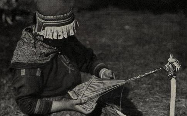 Sami woman weaving a band on a rigid heddle loom